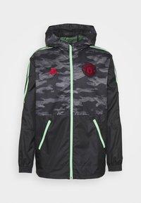 MANCHESTER UNITED WINDBREAKER - Training jacket - black