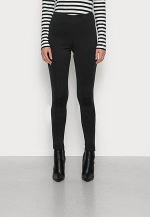 TECHNICAL SUPER SKINNY PANT - Trousers - black