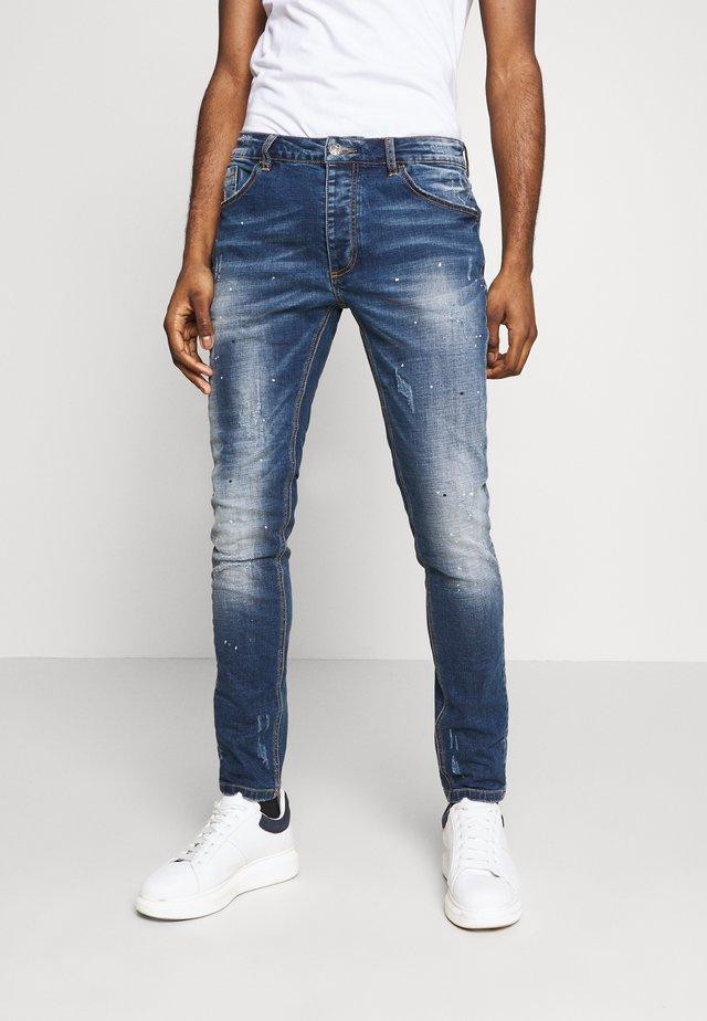 ROMMIE - Slim fit jeans - indigo wash