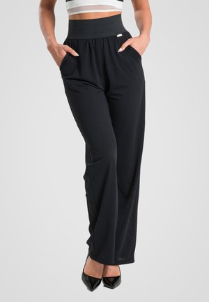 WATERFALL - Trousers - black