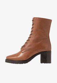 KIOMI - Winter boots - cognac - 1