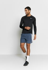 Nike Performance - DRY MILER - Sports shirt - black/silver - 1