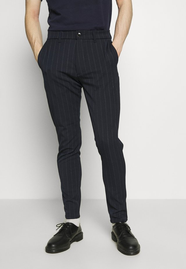 UGGE - Pantalones - dark saphire