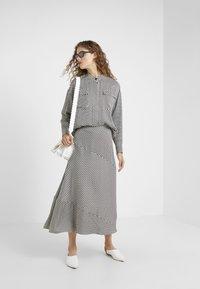 Lovechild - YOKO SKIRT - Maxi skirt - black - 1