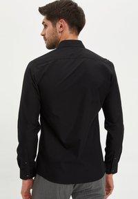 DeFacto - Formal shirt - black - 2