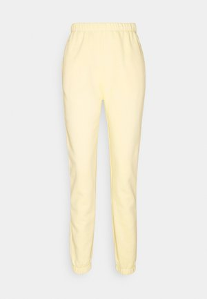 COZY PANTS - Tracksuit bottoms - yellow