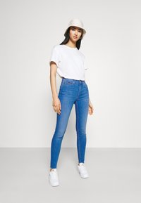 Tommy Jeans - NORA ANKLE - Jeans Skinny Fit - blue denim - 1