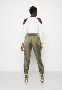 Guess - EUPHEMIA - Tracksuit bottoms - greek olive - 2