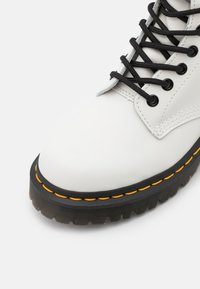 Dr. Martens - 1460 BEX 8 EYE BOOT UNISEX - Lace-up ankle boots - white smooth - 5