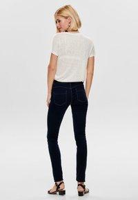 ONLY - ONLRILEY BLING - Print T-shirt - cloud dancer - 2