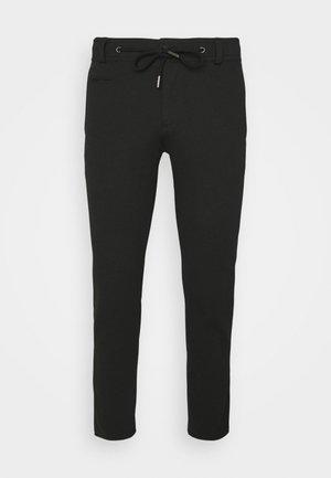 FLEXCITY - Pantalones deportivos - black