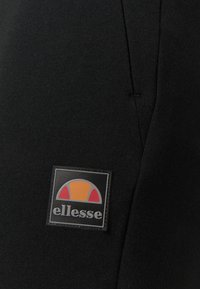 Ellesse - ZEHRI - Tracksuit bottoms - black - 2