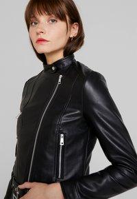 Vero Moda - VMEILEEN SHORT COATED JACKET - Faux leather jacket - black - 3