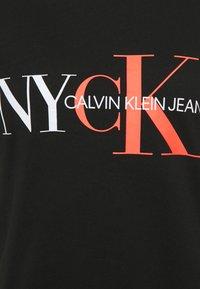 Calvin Klein Jeans - CLASSIC SLIM TEE - Print T-shirt - black - 2