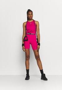 Nike Performance - TANK ALL OVER  - T-shirt sportiva - fireberry/white - 1