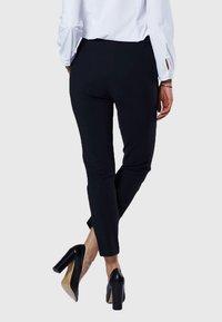 Evita - Pantalon classique - black - 2
