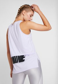 Nike Performance - TANK REBEL - Sports shirt - lavender mist/black