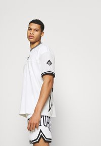 The Couture Club - VARSITY BADGED MESH DROP CROTCH SHORTS - Shorts - off white - 3