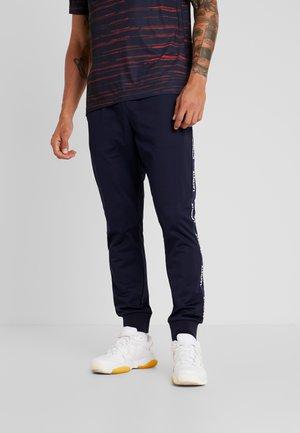 Tracksuit bottoms - navy blue/white