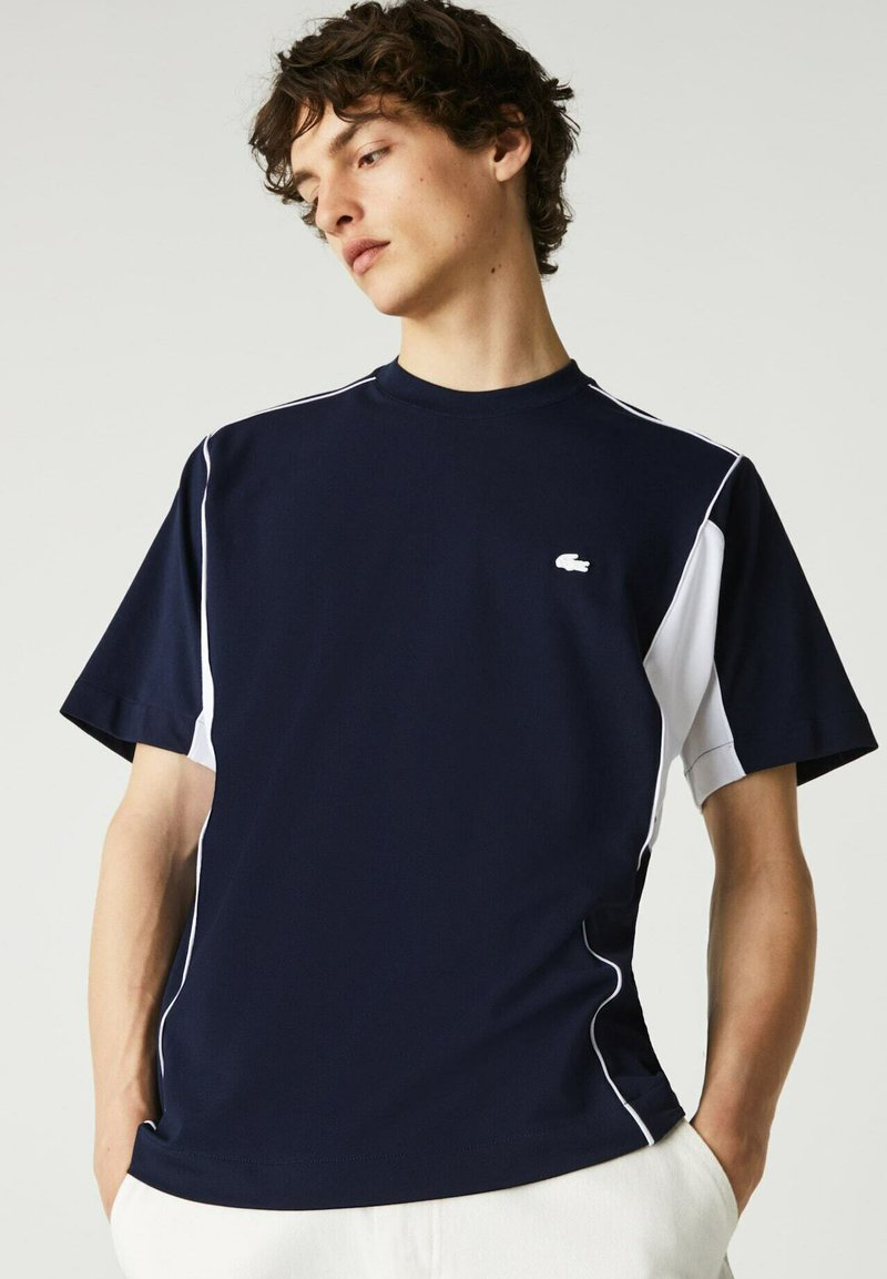 Lacoste - T-shirt print - navy blau/weiß