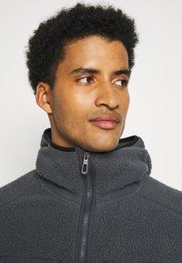 Salomon - SNOWSHELTER TED HOODIE - Fleece jacket - ebony - 3