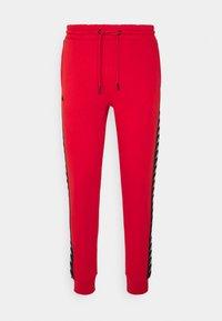 Kappa - Tracksuit bottoms - aurora red - 0