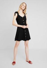 NAF NAF - LINA - Robe chemise - noir - 1