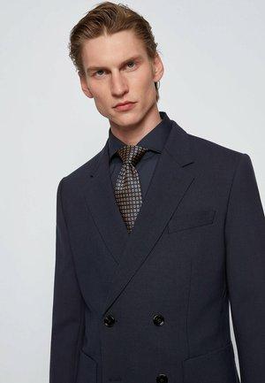Cravate - beige
