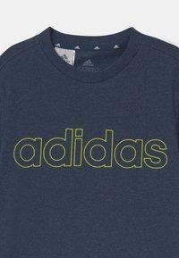 adidas Performance - UNISEX - T-Shirt print - dark blue/yellow - 2