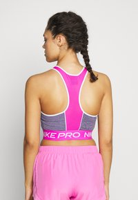 Nike Performance - DRY TANK CROP SPACE DYE - Tekninen urheilupaita - cerulean/fire pink/white - 2
