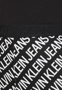 Calvin Klein Jeans - MILANO LOGO  - Leggings - Trousers - institutional black - 3