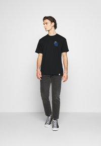 Carhartt WIP - SOCIETY - Print T-shirt - black - 1