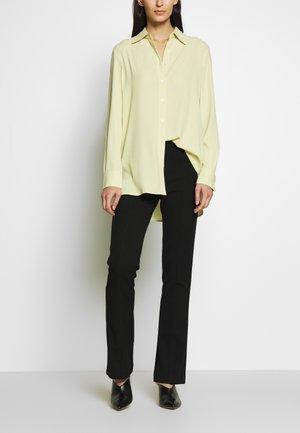 SLIM KICK FLARE PANT - Trousers - black