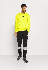 adidas Performance - COLORBLOCK ESSENTIALS - Tracksuit bottoms - black/medium grey heather - 1