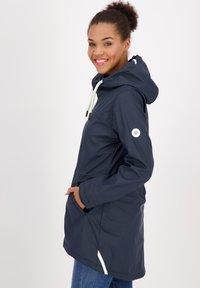 alife & kickin - Waterproof jacket - marine - 3