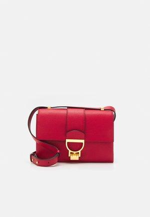 ARLETTIS - Across body bag - ruby