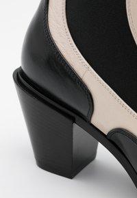 Casadei - Cowboy/biker ankle boot - sense nero/offwhite - 4