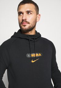 Nike Performance - AS ROM HOOD  - Article de supporter - black/safety orange - 3
