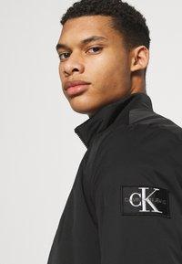 Calvin Klein Jeans - HARRINGTON PADDED JACKET - Light jacket - black - 4