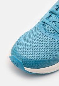 adidas Performance - FORTARUN UNISEX - Neutral running shoes - hazy blue/glow pink/hazy sky - 5