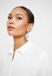 ONLY - ONLCABRINE EARRING - Korvakorut - silver-coloured
