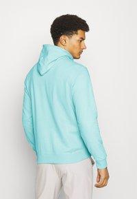 Champion - HOODED - Sweatshirt - turquoise - 2