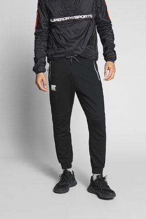 GYMTECH - Pantalon de survêtement - black