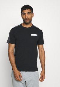 Calvin Klein Performance - SHORT SLEEVE - T-Shirt print - black - 0