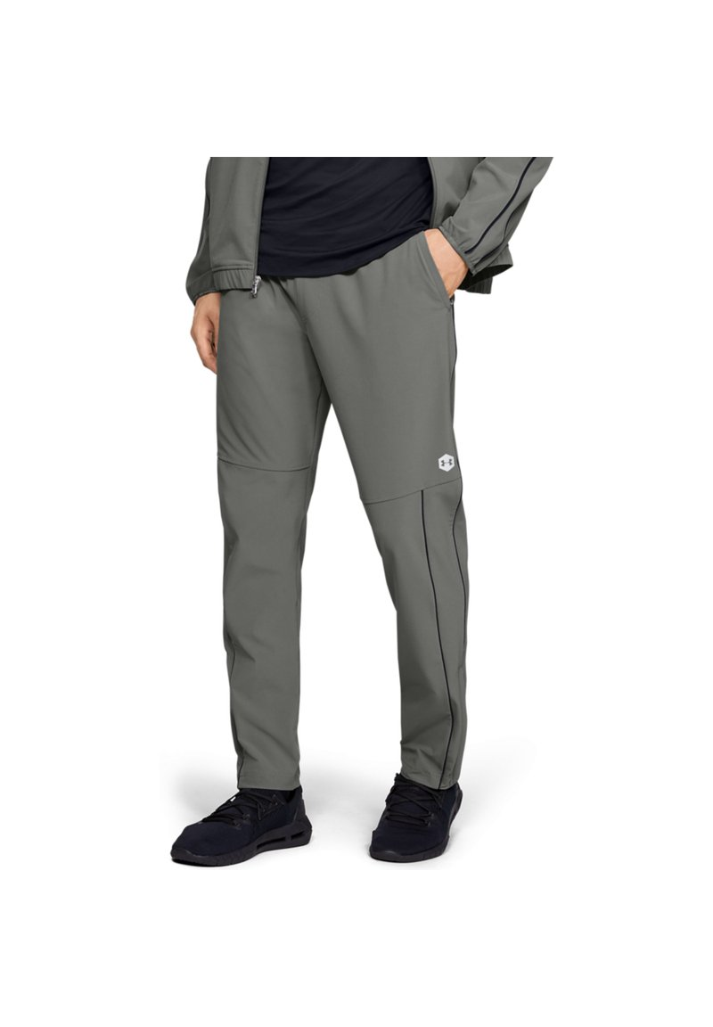 Under Armour - Tracksuit bottoms - gravity green