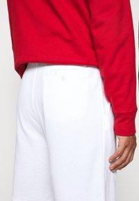 Polo Ralph Lauren - TERRY - Pantalon de survêtement - white - 3