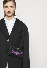 MM6 Maison Margiela - LOGO NEON ON TUC BAG SMALL - Bum bag - black - 0