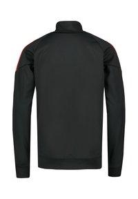Nike Performance - Training jacket - anthracite / bright crimson / white - 1