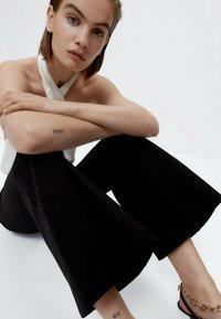 Uterqüe - Trousers - black - 4