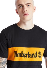 Timberland - CUT AND SEW TEE - Print T-shirt - black - 4